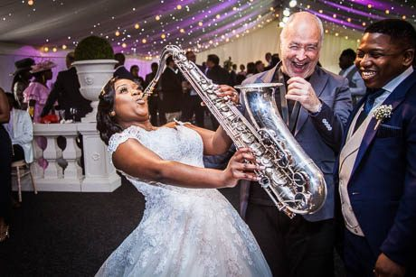 Bride playing the sax