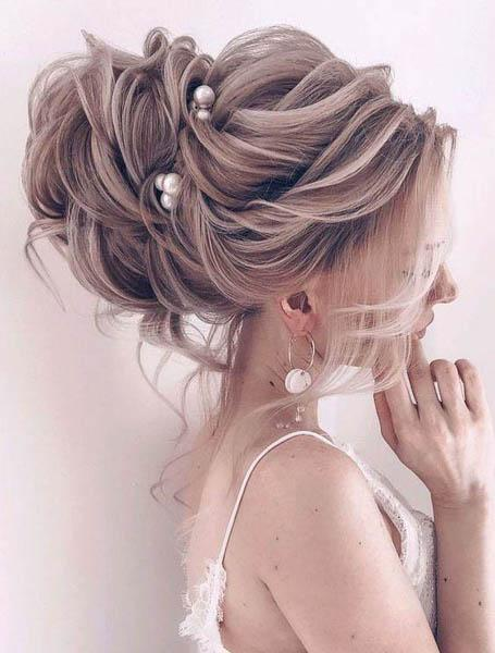 wedding hairstyles - Low Bun With Mini Bouffant and Side Sweep